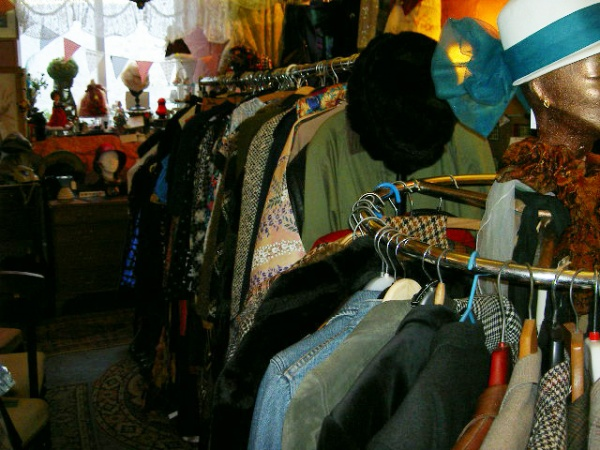 Racks and racks of vintage clothes, including Christmas party clothes